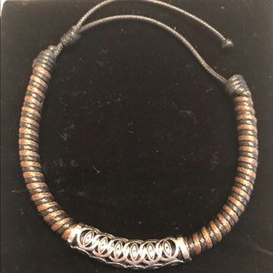 NWOT woven bracelet with metal detail